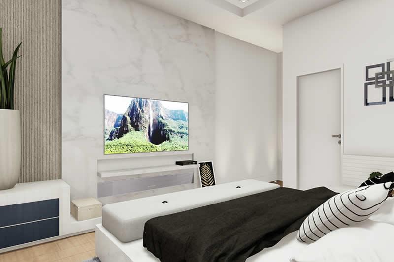 Quarto de casal com baú na frente da cama