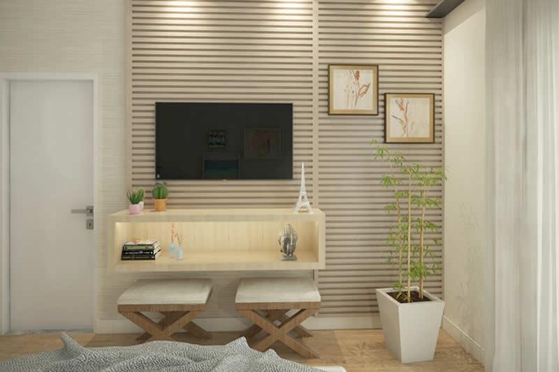 Quarto decorado com TV pequena