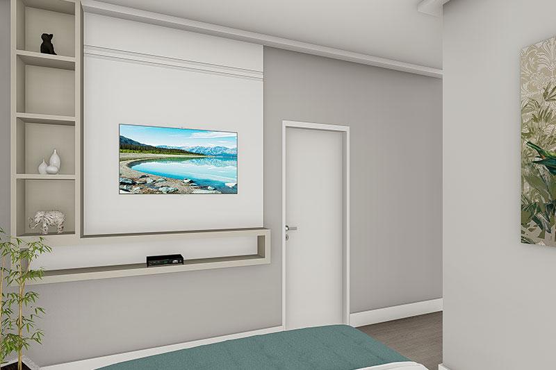Quarto com painel de tv em frente a cama