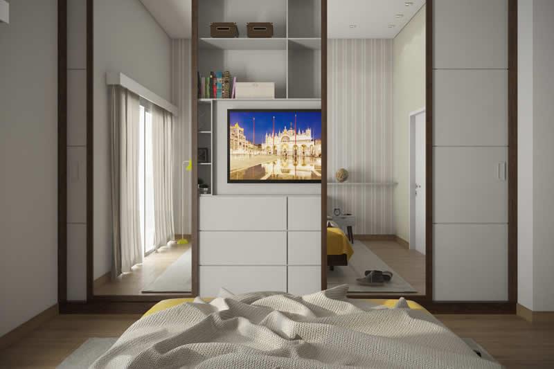 Quarto amarelo com TV